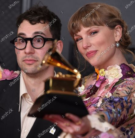 """Stock Picture of Jack Antonoff, left, and Taylor Swift pose in the press room with the award for album of the year for """"Folklore"""" at the 63rd annual Grammy Awards at the Los Angeles Convention Center"""
