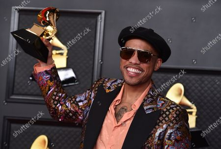 """Anderson Paak poses in the press room with the award for best melodic rap performance for """"Lockdown"""" at the 63rd annual Grammy Awards at the Los Angeles Convention Center"""