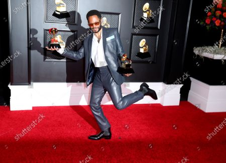 Editorial photo of Musical talent pose on the red carpet at the 63rd Annual Grammy Awards show in downtown Los Angeles, Los Angeles Convention Center, Los Angeles, California, United States - 14 Mar 2021