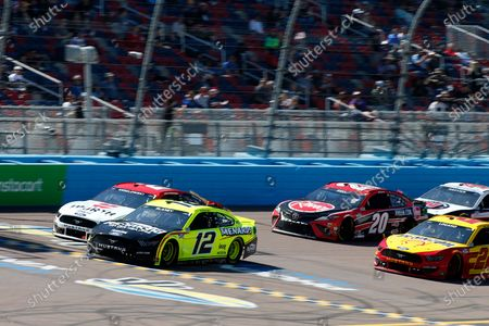 Ryan Blaney (12) leads Brad Keselowski (2), Joey Logano (22) and Christopher Bell (20) on a restart during the NASCAR Cup Series auto race at Phoenix Raceway, in Avondale, Ariz