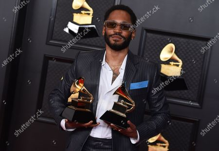 Stock Picture of Kaytranada poses in the press room with the award for best dance recording and dance electronic album, for Bubba, at the 63rd annual Grammy Awards at the Los Angeles Convention Center on March 14 with both live and prerecorded segments