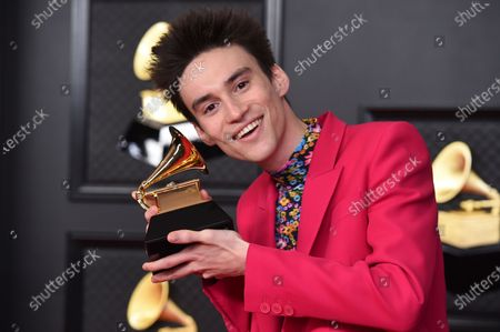 """Jacob Collier poses in the press room with the award for best arrangement, instruments and vocals for """"He Won't hold you"""" at the 63rd annual Grammy Awards at the Los Angeles Convention Center on March 14 with both live and prerecorded segments"""