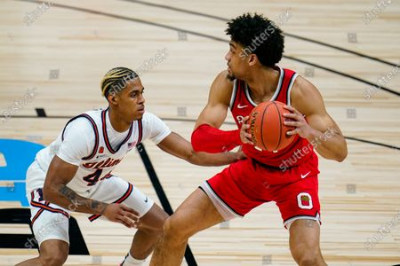 Illinois guard Adam Miller (44) defends Ohio State forward Justice Sueing (14) in an NCAA college basketball championship game at the Big Ten Conference tournament in Indianapolis
