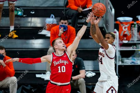 Stock Picture of Illinois guard Adam Miller (44) shoots over Ohio State forward Justin Ahrens (10) during the second half of an NCAA college basketball championship game at the Big Ten Conference tournament, in Indianapolis