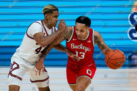 Ohio State guard CJ Walker (13) drives on Illinois guard Adam Miller (44) in an NCAA college basketball championship game at the Big Ten Conference tournament in Indianapolis