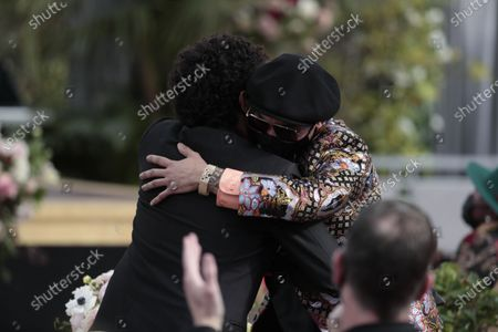 Anderson. Paak accepts the award for Best Melodic Rap Performance is hugged by Bruno Mars at the 63rd Grammy Award outside Staples Center