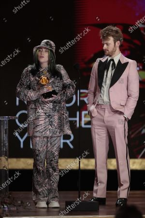 Stock Picture of Billie Eilish and brother Finneas O'Connell accepts the award for Album of the Year at the 63rd Grammy Award outside Staples Center