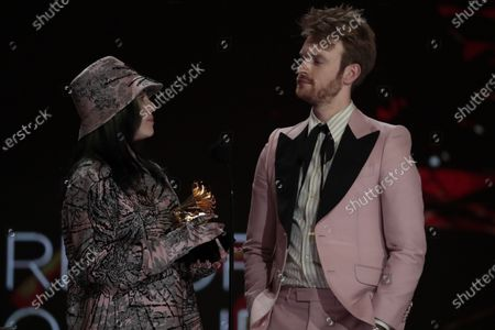 Billie Eilish and brother Finneas O'Connell accepts the award for Album of the Year at the 63rd Grammy Award outside Staples Center