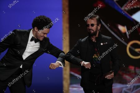Host Trevor Noah and Ringo Starr presented Record of the Year at the 63rd Grammy Award outside Staples Center