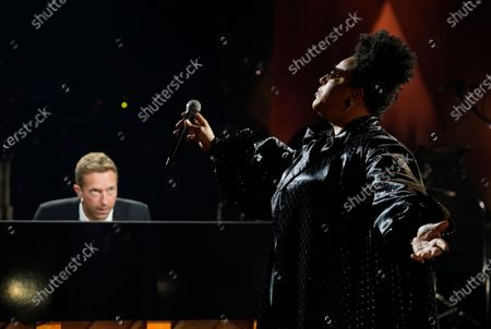 """Brittany Howard, right, and Chris Martin perform together during the """"In Memoriam"""" section of the 63rd Grammy Awards at the Los Angeles Convention Center,. The awards show airs on March 14 with both live and prerecorded segments"""