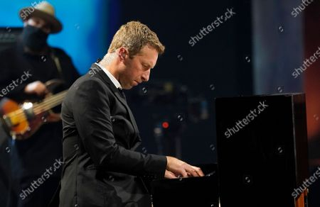 """Chris Martin performs during the """"In Memoriam"""" section of the 63rd Grammy Awards at the Los Angeles Convention Center,. The awards show airs on March 14 with both live and prerecorded segments"""
