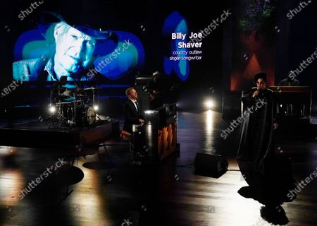 """Chris Martin, left, and Brittany Howard perform in front of a portrait of the late singer Billy Joe Shaver during the """"In Memoriam"""" section of the 63rd Grammy Awards at the Los Angeles Convention Center,. The awards show airs on March 14 with both live and prerecorded segments"""