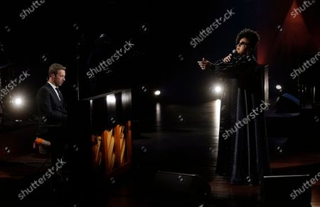 """Chris Martin, left, and Brittany Howard perform together during the """"In Memoriam"""" section of the 63rd Grammy Awards at the Los Angeles Convention Center,. The awards show airs on March 14 with both live and prerecorded segments"""