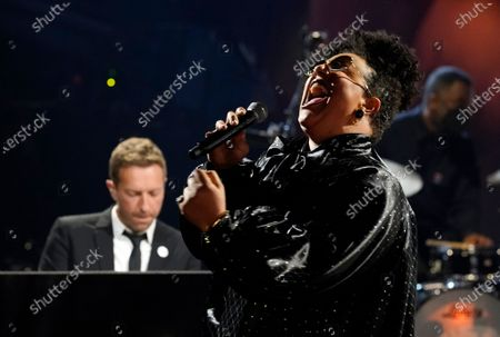 """Brittany Howard performs with Chris Martin, left, during the """"In Memoriam"""" section of the 63rd Grammy Awards at the Los Angeles Convention Center,. The awards show airs on March 14 with both live and prerecorded segments"""