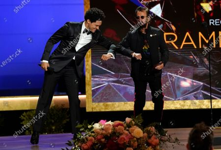 Trevor Noah, left, and host Ringo Starr appear on stage at the 63rd annual Grammy Awards at the Los Angeles Convention Center on March 14 with both live and prerecorded segments