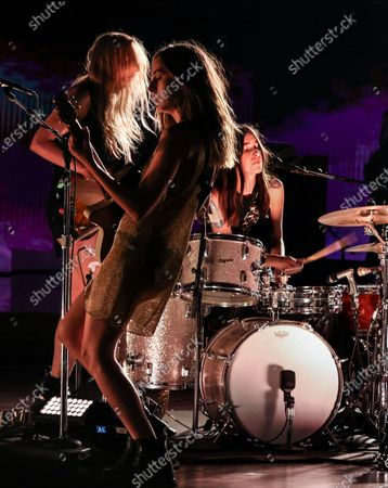 Haim performs for a pre-taped segment for the 63rd Grammys at the LA Convention Center. Left to right are - Esta, Alana and Danielle Haim