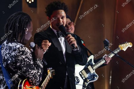 Host Trevor Noah fist bumps Black Pumas lead singer Eric Burton during a pre-taped segment for the 63rd Grammys at the LA Convention Center