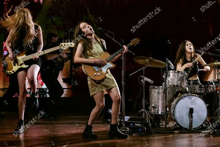 Stock Image of Haim performs for a pre-taped segment for the 63rd Grammys at the LA Convention Center. Left to right are - Esta, Alana and Danielle Haim