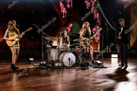Trevor Noah with Haim during a pre-taped segment for the 63rd Grammys at the LA Convention Center