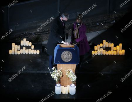 "Mayor Bill De Blasio and First Lady Chirlane McCray prepare to host ""A COVID-19 Day of Remembrance,"" a live official memorial ceremony to honor the more than 30,000 New Yorkers lost during the Coronavirus pandemic in New York City on Sunday, March 14, 2021. Hundreds of New Yorkers who have lost their lives due to COVID had their images projected onto the Brooklyn Bridge Sunday night as part of the city's virtual memorial honoring the memory of local COVID-19 victims."