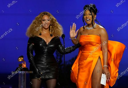 """Stock Image of Beyonce Knowles, left, and Megan Thee Stallion accept the award for best rap song for """"Savage"""" at the 63rd annual Grammy Awards at the Los Angeles Convention Center"""