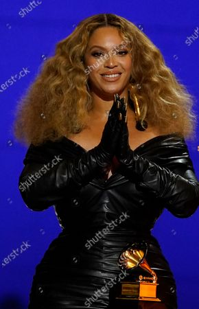 """Beyonce Knowles accepts the award for best rap song for """"Savage"""" at the 63rd annual Grammy Awards at the Los Angeles Convention Center"""