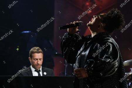 Brittany Howard and Chris Martin perform for a pre-taped segment for the 63rd Grammys at the LA Convention Center.