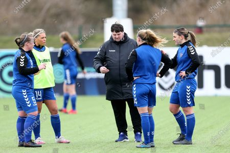 Lee Sanders the Durham Women's manager gives ome last minute instructions to (L-R) Sarah Wilson, Becky Salicki , Abby Holmes and Ellie Christon  during the FA Women's Championship match between Durham Women FC and Leicester City at Maiden Castle, Durham City, England on 14th March 2021.