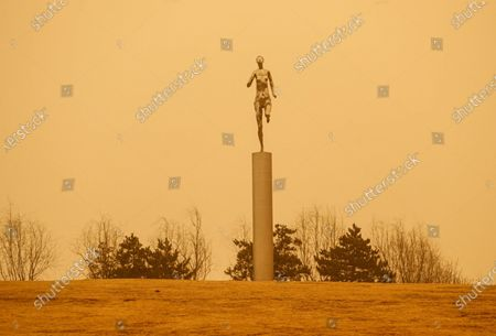 Stock Picture of On March 15, 2021, Shenyang, Liaoning Province, suffered from dust weather. According to the central meteorological station, 12 provinces and cities in the north have large-scale yellow sand. From the morning of the 14th to the 15th, affected by cold air, dust or floating dust appeared in the western part of the southern Xinjiang basin, central and western Gansu, Inner Mongolia and Northern Shanxi, northern Hebei and Beijing, and dust storms occurred in some areas. This morning, the Central Meteorological Observatory upgraded the sandstorm warning to yellow warning: it is estimated that 12 provinces, including Xinjiang, Inner Mongolia, Gansu, Ningxia, Shaanxi, Shanxi, Hebei, Beijing, Tianjin, Heilongjiang, Jilin and Liaoning, will have obvious sandstorm weather from day to night on the 15th, and some areas will have sandstorms. This is also the strongest dust weather process in China in recent 10 years, and the range of dust storm is also the widest in recent 10 years.