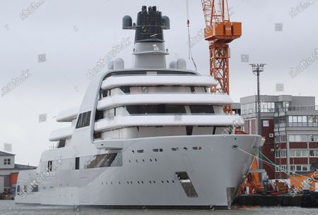 A newly-built mega yacht is moored at a quai of the Lloyd-Werft shipyards in Bremerhaven, northern Germany, 15 March 2021. According to a report of German float Magazin, the 140 meters long ship is the 'Solaris', an expedition yacht owned by Russian billionaire Roman Abramovich. As the Llyod shipyards could be shut down in near future due to financial problems, the ship might be the last mega yacht build in their docks.