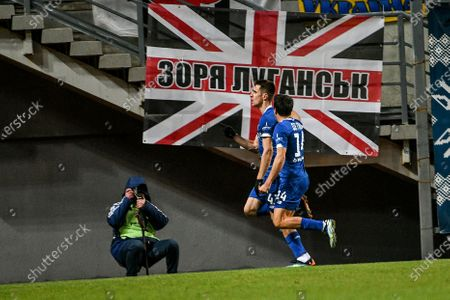 Midfielder Carlos de Pena (front) of FC Dynamo Kyiv congratulates his teammate, forward Artem Besedin on scoring the opener in the 55th minute during the 2020/2021 Ukrainian Premier League Matchday 18 game against FC Zorya Luhansk at the Slavutych Arena, Zaporizhzhia, southeastern Ukraine.