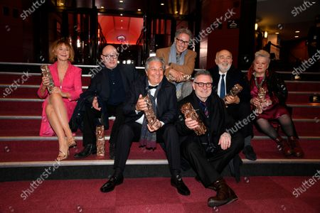 Stock Picture of From the left, actress Marie-Anne Chazel, actor Michel Blanc, French actors Christian Clavier, actor Thierry Lhermitte, behind, Gerard Jugnot, second right, actor Laurent Lafitte, front third right, and actress Josiane Balasko, all from the Splendid theater, pose with their Cesar awards after the 46th Cesar Award ceremony on in Paris