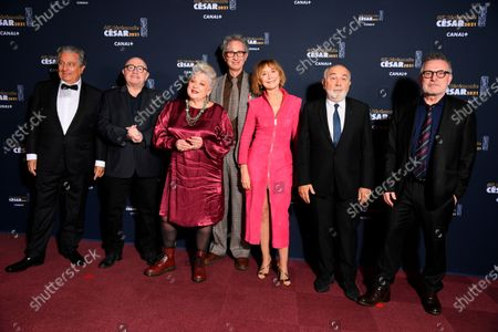 From the left, French actors Christian Clavier, actor Michel Blanc, actress Josiane Balasko, actor Thierry Lhermitte, actress Marie-Anne Chazel, Gerard Jugnot and actor Laurent Lafitte, all from the Splendid theater, pose during the 46th Cesar Award ceremony on in Paris