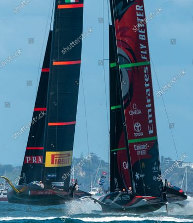 Stock Photo of Defender's Emirates Team New Zealand (ETNZ), skippered by Peter Burling on Te Rehutai and Italian challengers Luna Rossa Prada Pirelli, co-helmed by Jimmy Spithill and Francesco Bruni on Luna Rossa, during Day 7, Race 10, of the 36th America's Cup.  ETNZ won to retain the America's Cup.