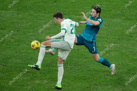 Forward Sardar Azmoun of FC Zenit and defender Zoran Nizic of FC Akhmat vie for the ball