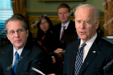 Stock Image of Gene Sperling, Assistant to the President for Economic Policy and Director of National Economic Council, left, listens as Vice President Joe Biden speaks during Biden's meeting with CEO's in the Eisenhower Executive Office Building in Washington. Sperling, a veteran of the Clinton and Obama administrations, will lead the oversight for distributing funds from President Joe Biden's $1.9 trillion coronavirus rescue package, a White House official said Monday