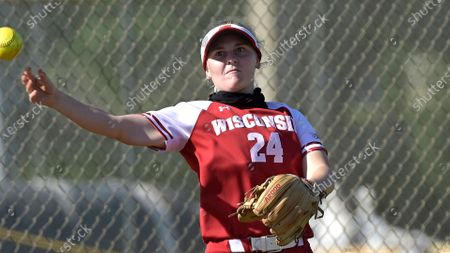Stock Picture of Wisconsin infielder Lauren Foster (24) throws after fielding a ball during an NCAA college softball game against Michigan, in Leesburg, Fla