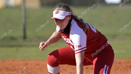 Stock Photo of Wisconsin infielder Lauren Foster (24) has a throw get past her during an NCAA college softball game against Michigan, in Leesburg, Fla