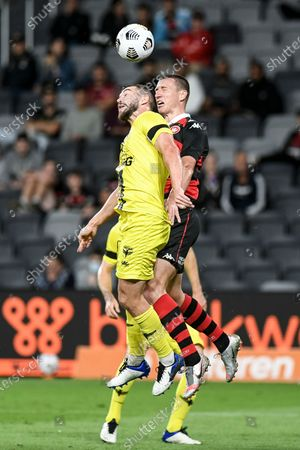 Stock Photo of Mitch Duke of Western Sydney Wanderers and Tim Payne of Wellington Phoenix challenge for the header; Bankwest Stadium, Parramatta, New South Wales, Australia; A League Football, Western Sydney Wanderers versus Wellington Phoenix.