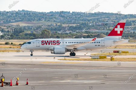 Stock Image of Swiss International Air Lines Airbus A220-100 the former Bombardier CS100 aircraft as seen taxiing after landing in Thessaloniki International Airport Makedonia SKG LGTS in Greece. The narrow body regional airplane has the registration HB-JBH, the name Ascona and is powered by 2x PW jet engines. Swiss International Air Lines known as SWISS or Swiss Air Lines SWR LX is the flag carrier of Switzerland with hub in Zurich. The airline is member of Star Alliance aviation group and is owned by Lufthansa Group. The world passenger traffic declined during the coronavirus covid-19 pandemic era with the industry struggling to survive while passengers keep obligatory safety measures during the flights such as facemask, negative test and quarantine. Thessaloniki, Greece on October 12, 2020