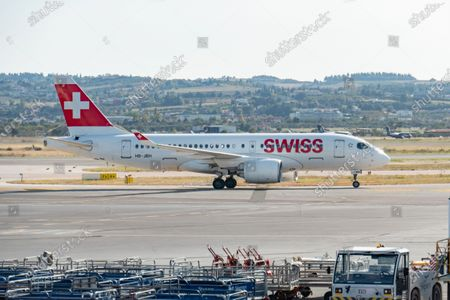 Swiss International Air Lines Airbus A220-100 the former Bombardier CS100 aircraft as seen taxiing after landing in Thessaloniki International Airport Makedonia SKG LGTS in Greece. The narrow body regional airplane has the registration HB-JBH, the name Ascona and is powered by 2x PW jet engines. Swiss International Air Lines known as SWISS or Swiss Air Lines SWR LX is the flag carrier of Switzerland with hub in Zurich. The airline is member of Star Alliance aviation group and is owned by Lufthansa Group. The world passenger traffic declined during the coronavirus covid-19 pandemic era with the industry struggling to survive while passengers keep obligatory safety measures during the flights such as facemask, negative test and quarantine. Thessaloniki, Greece on October 12, 2020