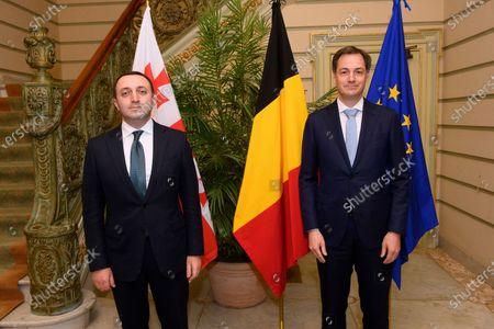 Belgium Prime Minister Alexander De Croo (R) welcomes Georgian Prime Minister Irakli Garibashvili prior to a meeting in Brussels, Belgium, 15 March 2021.