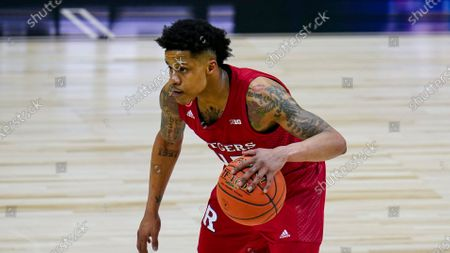 Rutgers guard Jacob Young (42) plays against Illinois in the first half of an NCAA college basketball game at the Big Ten Conference tournament in Indianapolis