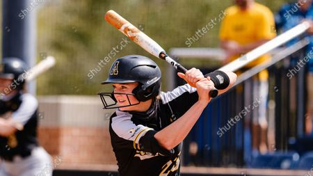 Stock Image of Emma Jones of Appalachia State is up to bat against South Alabama during an NCAA softball game, in Mobile, Ala