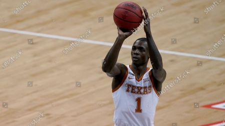 Texas's Andrew Jones puts up a shot during the first half of an NCAA college basketball game against Oklahoma State for the Big 12 tournament championship in Kansas City, Mo