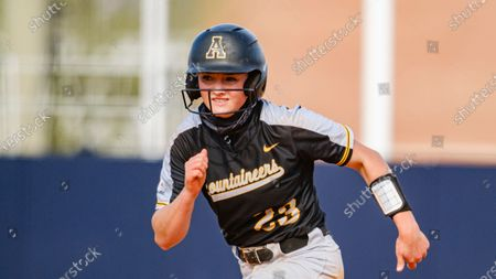 Emma Jones of Appalachian State runs for third base while playing against South Alabama during an NCAA softball game, in Mobile, Ala