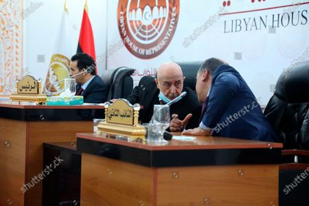 The head of Libya's parliament, speaker Aguila Saleh, center, and his deputy speak during the swearing-in ceremony for the country's new interim government in Tobruk, Libya, . Libyan Prime Minister Abdul Hamid Dbeibah's interim government is to replace the country's two rival administrations and lead the war-torn North African nation through elections later this year. Libya was plunged into chaos following a NATO-backed uprising in 2011 that toppled and later killed long-time dictator Moammar Gadhafi