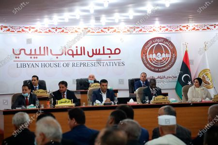 Stock Photo of Leaders of Libya's parliament, headed by speaker Aguila Saleh (center rear) preside over the swearing-in ceremony for the country's new interim government in Tobruk, Libya, . Libyan Prime Minister Abdul Hamid Dbeibah's interim government is to replace the country's two rival administrations and lead the war-torn North African nation through elections later this year. Libya was plunged into chaos following a NATO-backed uprising in 2011 that toppled and later killed long-time dictator Moammar Gadhafi
