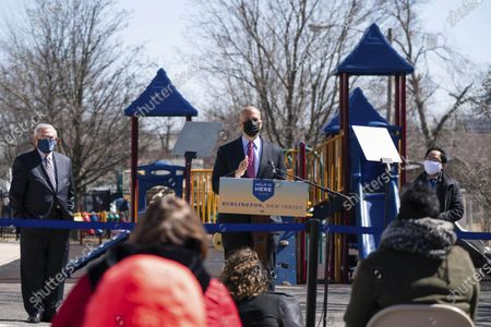 Sen. Cory Booker, D-N.J., speaks at a playground outside of the Samuel Smith Elementary School in Burlington, N,J.,, ahead of first lady Jill Biden. At left is New Jersey Gov. Phil Murphy and at right is Rep. Andy Kim, D-N.J