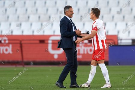 Stock Photo of Jose Gomes of Almeria and Jose Corpas of Almeria greets each other during the La Liga Smartbank match between UD Almeria and UD Las Palmas at Estadio Juegos del Mediterraneo on February 14, 2021 in Almeria, Spain. Sporting stadiums around Spain remain under strict restrictions due to the Coronavirus Pandemic as Government social distancing laws prohibit fans inside venues resulting in games being played behind closed doors.